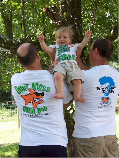 Our littlest Bob the Fish fan with dad and granddad!