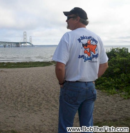 Bob with Bob the Fish touring northern Michigan. Mackinac Bridge, Mackinaw City, Michigan