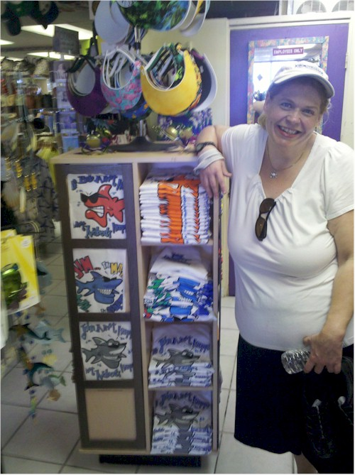 Brandy from Florida standing next to a Bob the Fish display at Pier Peddlers on Ft. Myers Beach.