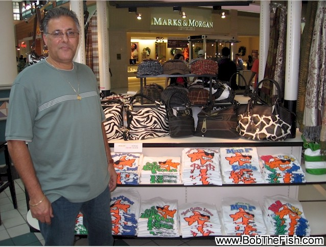 Gabriel from Amelia Island Clothing & Gifts doing a fantastic job selling Bob The Fish in the Jacksonville Florida Mall