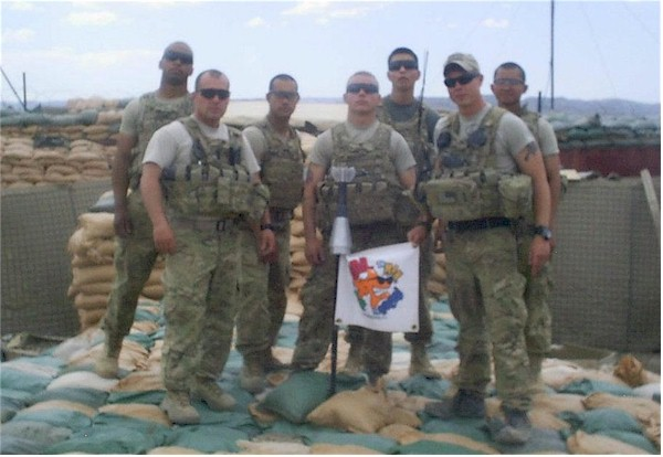 My son, Staff Sgt. Groover (Robby) flying the Bob the Fish flag over Combat Operations Post Boris, Afghanistan.