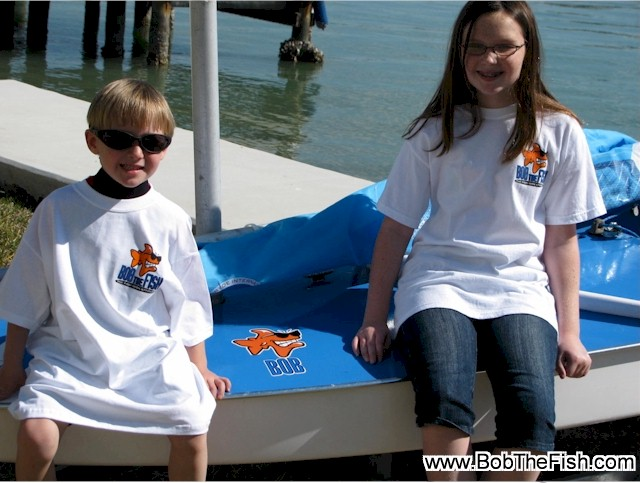 Florida / Bob, As promised here are a couple of shots of the kids with their new sailboat christened