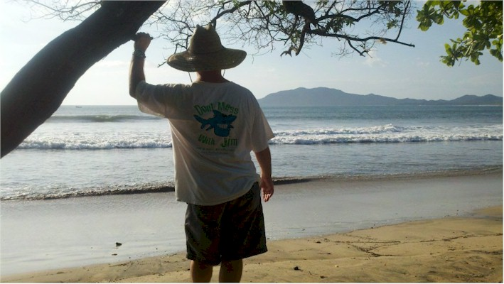 Jim the Shark Goldberg in Costa Rica watching the beautiful sunset from the waters edge.
