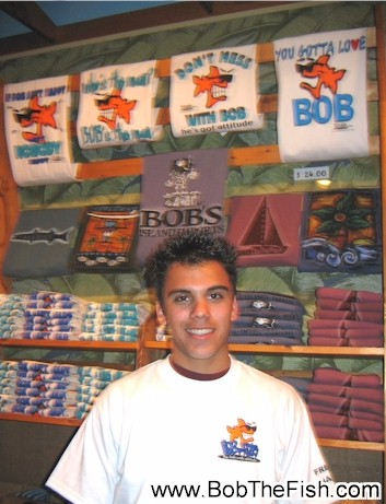 Dear Bob, My boyfriend Bobby loves your t-shirts so much that his only wish in life has become to have his picture posted on your website. This is him in the store