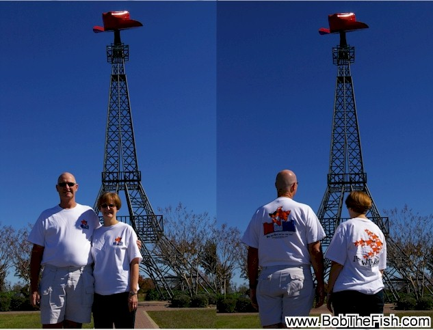 Greetings. Thought we would send a couple of pictures of me and my wife with our Bob the Fish shirts. We live in Paris, TX, the 2nd largest Paris in the world, and took some pictures of us in our Bob shirts in front of our Eiffel Tower with a cowboy hat! Bob and Barbie Ricks Eiffel Tower in Paris (TX)!!!