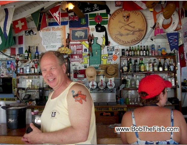 Terry with his Bob the Fish tattoo on Norman Island, BVI